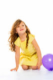 Playful little girl in yellow dress laughing Royalty Free Stock Photos