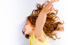 Playful little girl in yellow dress open arms Stock Photography