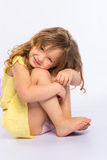 Playful little girl in yellow dress Stock Images