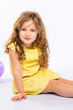 Playful little girl in yellow dress Royalty Free Stock Photography