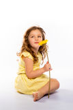 Playful little girl in yellow dress Stock Photos
