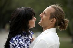 Playful love couple smiling in summer park. Playful love couple smiling outdoors Stock Images