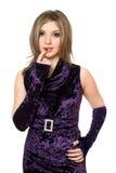 Playful lovely girl in a purple dress. Playful lovely girl in a purple velvet dress Stock Image