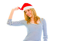 Playful lovely teen girl in Santa hat Stock Image