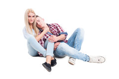 Playful and loving couple sitting on the floor Stock Image