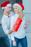 Playful man giving his wife a Christmas gift Stock Photo