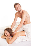 Playful man giving his wife a massage Royalty Free Stock Photo
