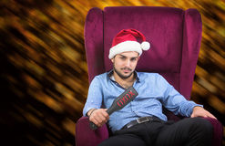 Playful man in Santa's red hat Royalty Free Stock Photography