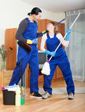Playful man and woman cleaning Royalty Free Stock Photos