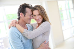 Playful middle aged couple at home royalty free stock image
