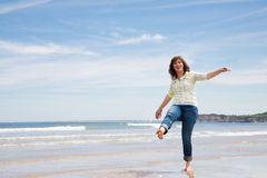 Playful middle aged woman on the beach Royalty Free Stock Image