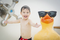 Playful Mixed Race Boy Having Fun at the Water Park Stock Images