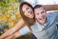 Playful Mixed Race Couple Portrait in the Park Stock Photography