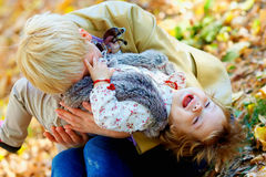 Playful mother and baby having fun in autumn park Royalty Free Stock Photo
