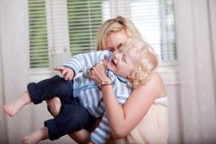 Playful Mother with Child Stock Images