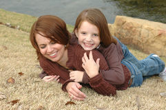 Playful mother and daughter Stock Image
