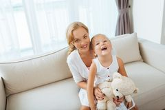 Playful mother and daughter Stock Photos