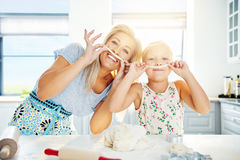 Playful Mum and daughter with pastry mustaches Royalty Free Stock Photo