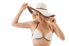 Playful nice blonde girl in bikini and hat Stock Photos