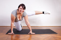 Playful overweight woman exercising Royalty Free Stock Photo