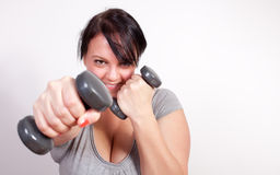 Playful overweight woman exercising Stock Photo