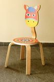 Playful painted chair for children Royalty Free Stock Image