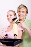 Playful painting couple Stock Photos