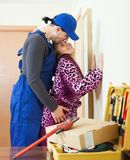 Playful plumber and housewife flirting Stock Photography