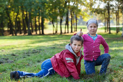 Playful preschool children posing in autumn park, thumb up Royalty Free Stock Image