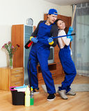 Playful professional cleaners Royalty Free Stock Images