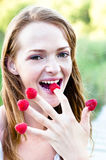 Playful with rapsberries Stock Photos