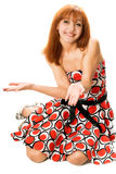 Playful red-haired girl in a dress Stock Image