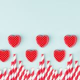 Playful red hearts and straws as border on fashion mint pastel color background, square. Happy modern holiday Valentine`s day backdrop Stock Image