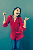 Playful 30s woman dancing with dynamic hand gesture Stock Photos