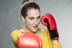 Playful 20s woman enjoying competition and fight Royalty Free Stock Image