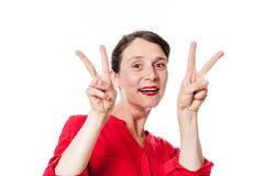 Playful 30s woman with two v victory signs approving Royalty Free Stock Photo