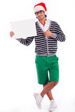 Playful santa boy with a blank board Royalty Free Stock Photo
