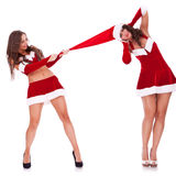 Playful santa women Stock Photos