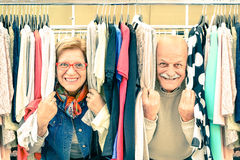 Playful senior couple at weakly flea market. Concept of active elderly with mature men and women having fun and shopping in the old town - Happy retirement Stock Photos