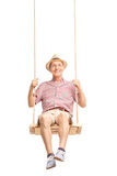 Playful senior swinging on a swing Royalty Free Stock Photos