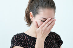 Playful shy woman hiding face with her hands Stock Photos