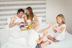 Playful siblings with parents on bed Royalty Free Stock Photography