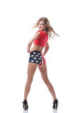 Playful slim woman posing in patriotic costume Royalty Free Stock Photography