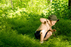 Playful small boy discovering nature Stock Photos
