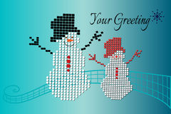 Playful snowmen over teal background Stock Image