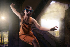 Playful stylish girl in orange overalls Royalty Free Stock Images