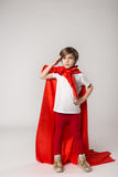Playful superwoman child posing in studio Royalty Free Stock Images