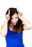 Playful  teen girl shows horns Royalty Free Stock Images