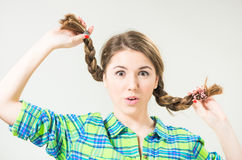 Playful teen with long pigtails Royalty Free Stock Image