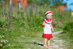 Playful toddler girl in meadow Royalty Free Stock Photos